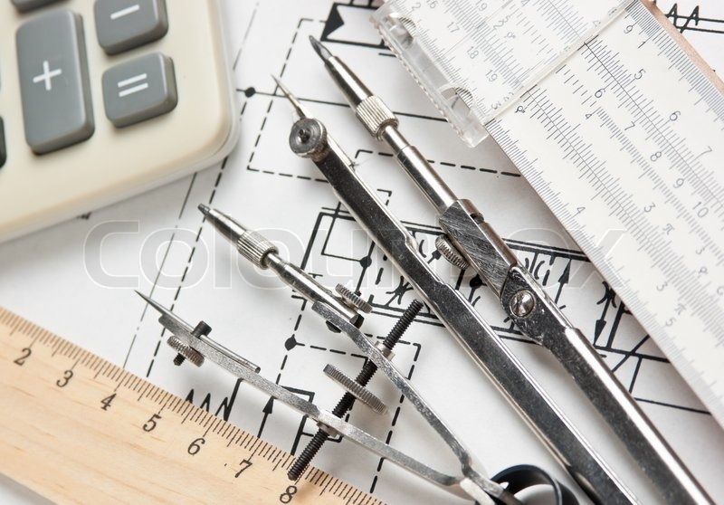 Engineering tools on technical drawing, stock photo