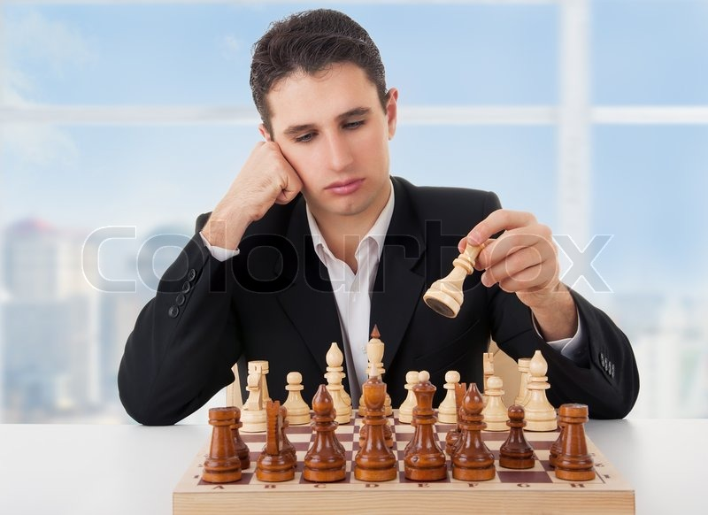 Business man playing chess, making the move | Stock Photo ...