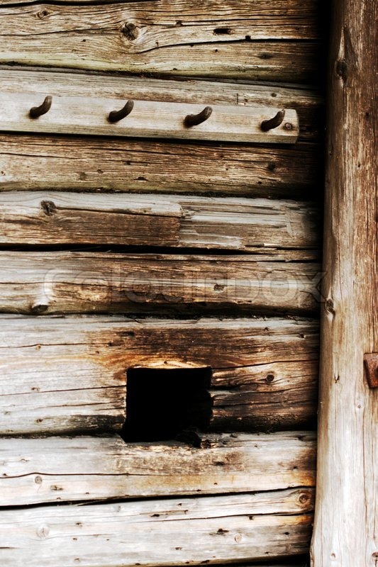 Detail of smoke hole in the wall of old smoke sauna, stock photo