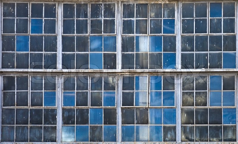 Old Factory Windows Texture With Blue Sky Reflections