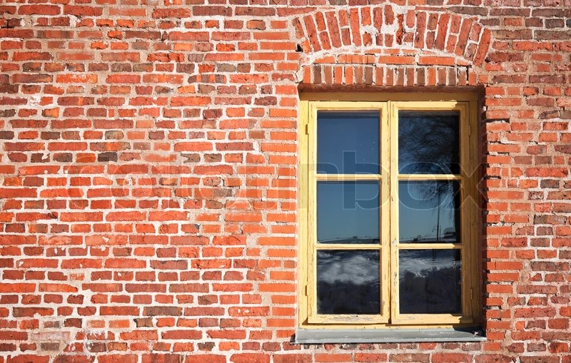 Background texture of old red brick wall with window, stock photo