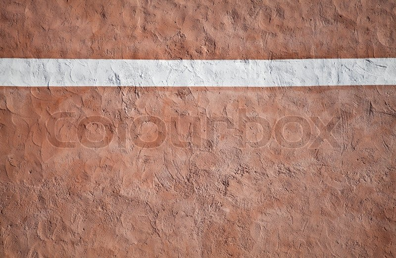 painted stone wallCloseup red painted stone wall texture with red plaster and white