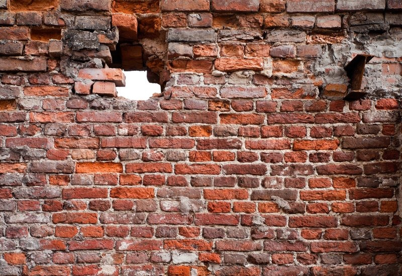 Brick wall texture with hole | Stock Photo | Colourbox