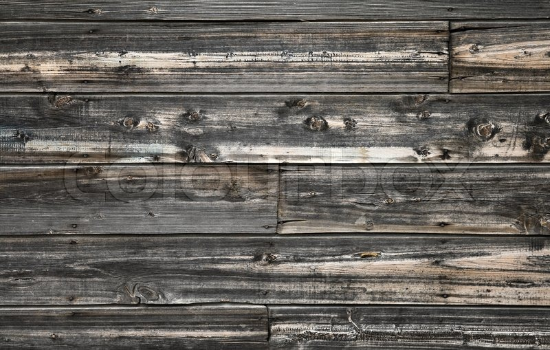 vintage wooden wall texture with siding nails and knots stock