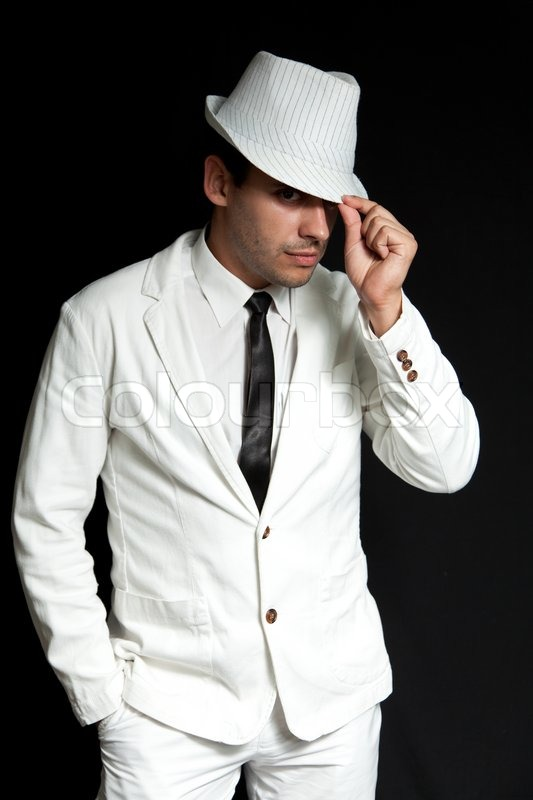 hat joy sexual young man wearing white suit and black tie portrait