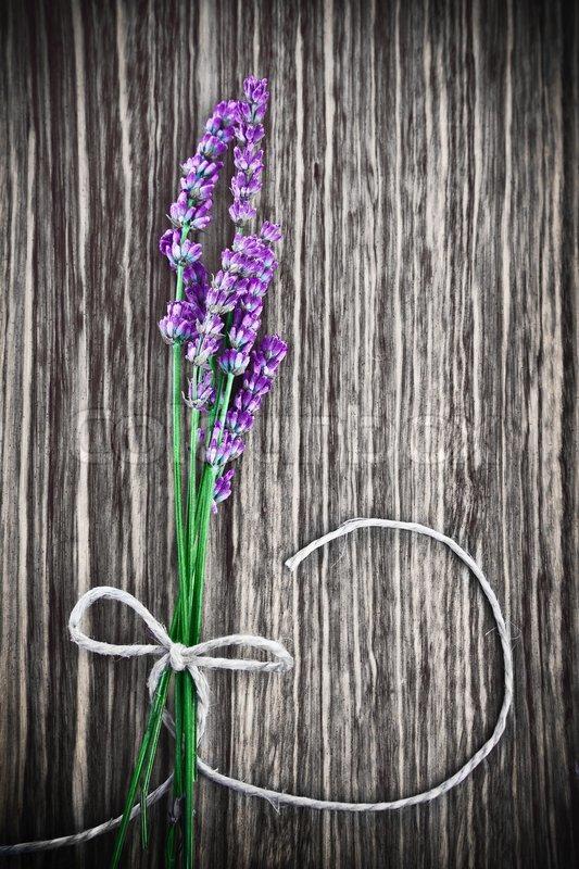 Photo of lavender flower on wooden textured grey background, bouquet ...