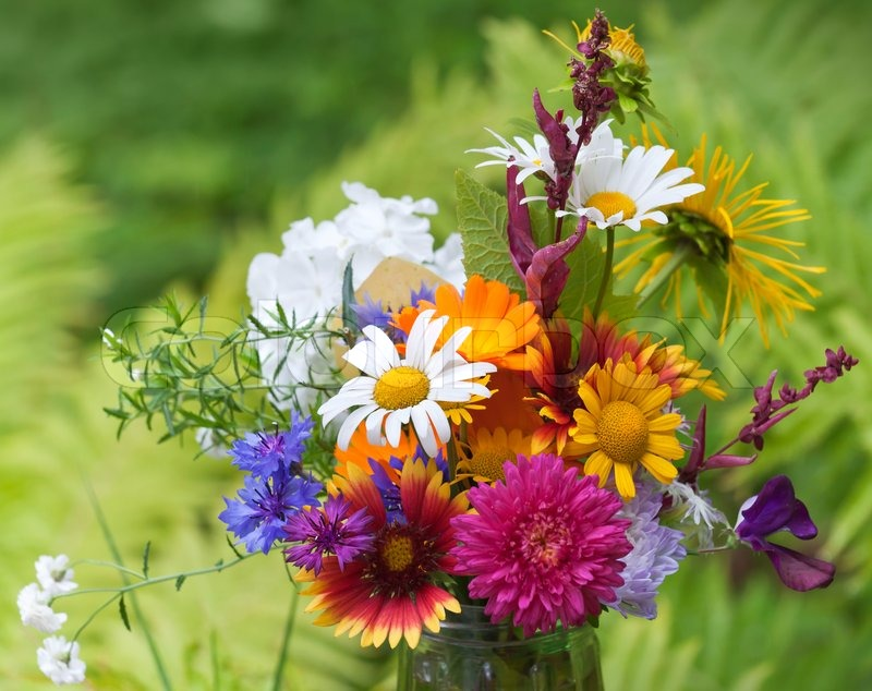 Bright colorful bouquet of garden and wild natural flowers, selective focus, stock photo