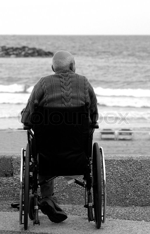 Vertical Oriented Image Of Unidentified Old Man Sitting On