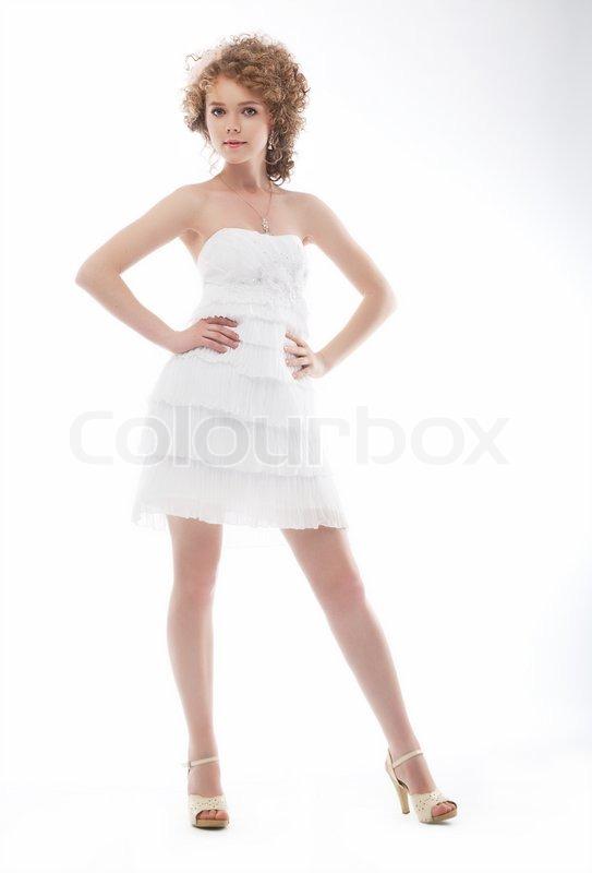 Beauty young bride in elegant white short wedding dress | Stock ...