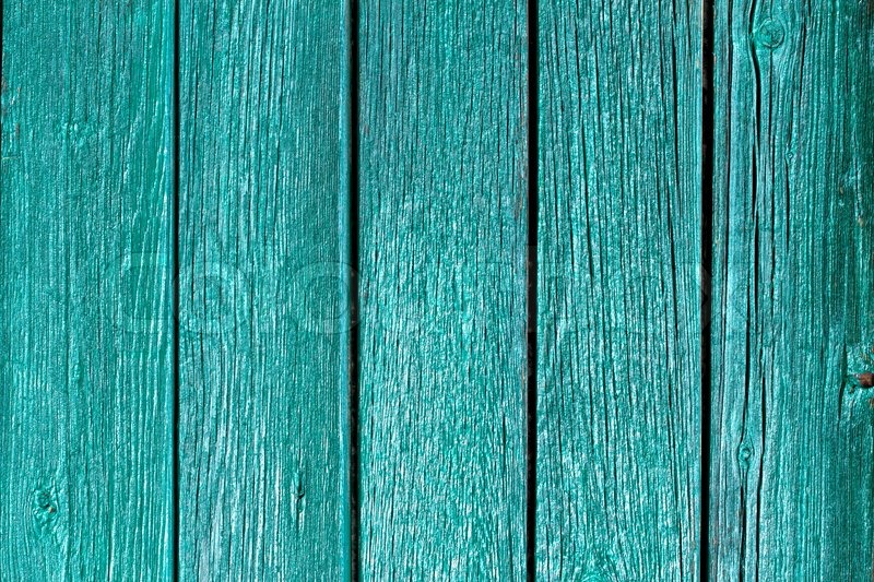 Painted wooden fence with green paint stock photo - How to paint a wood fence ...