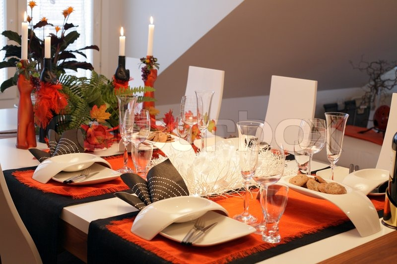 Fine Dining Table Laid For Four With Lit Candles In Modern Loft Aparment St