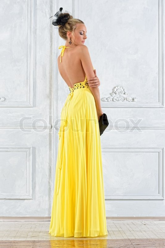 Beautiful blonde woman in a long yellow dress. | Stock Photo ...