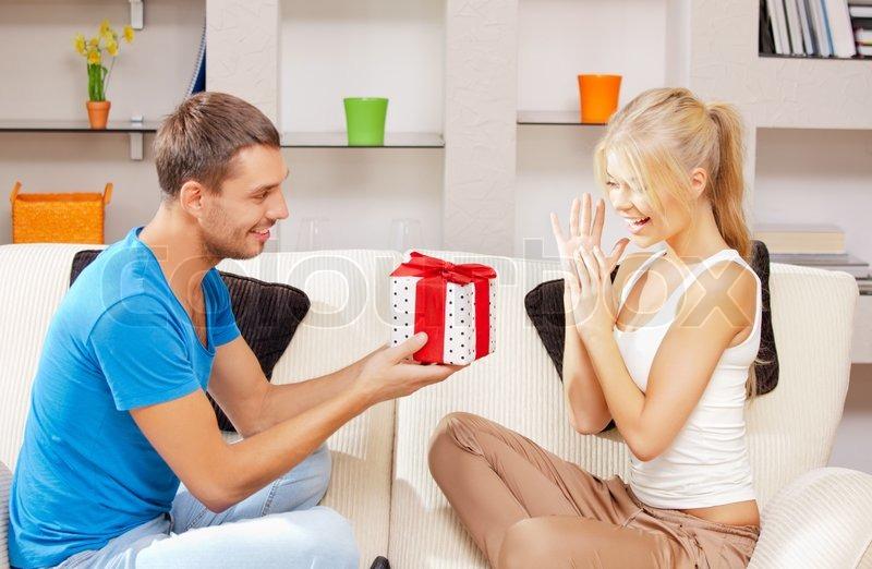 happy romantic couple with gift stock photo colourbox