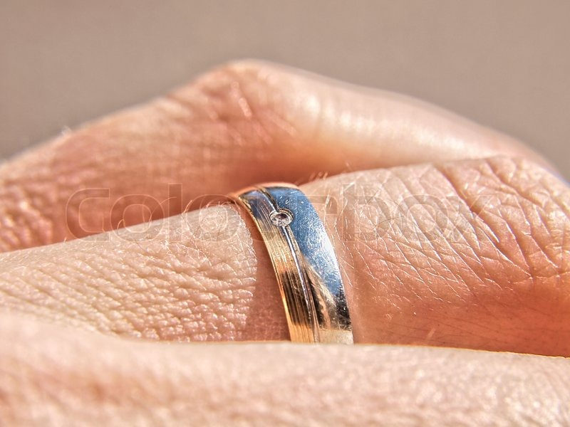 Wedding ring male hand Stock