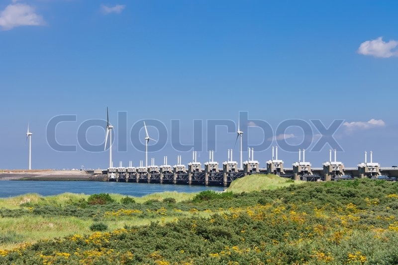 Wind turbines near the storm barrier Netherlands, stock photo
