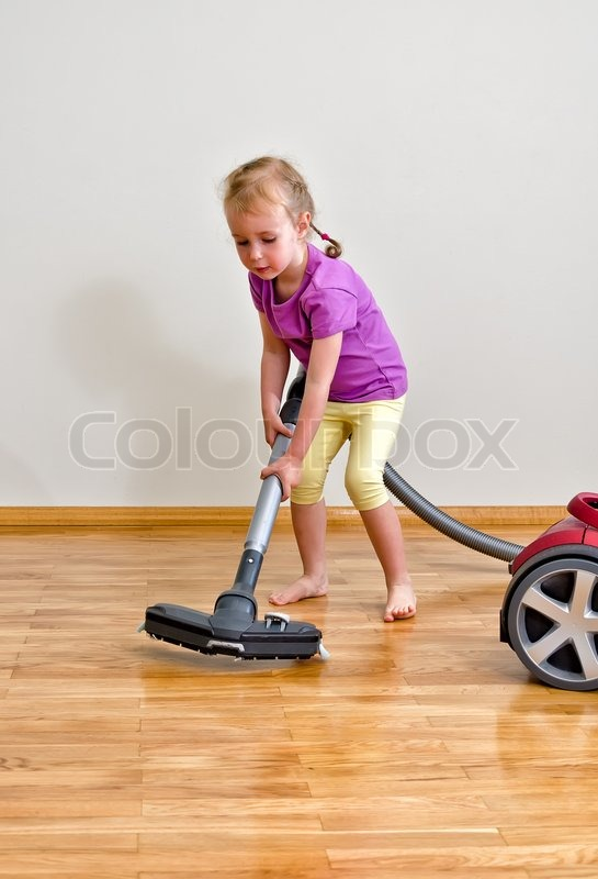 Cute Little Girl Cleaning Floor With Stock Photo