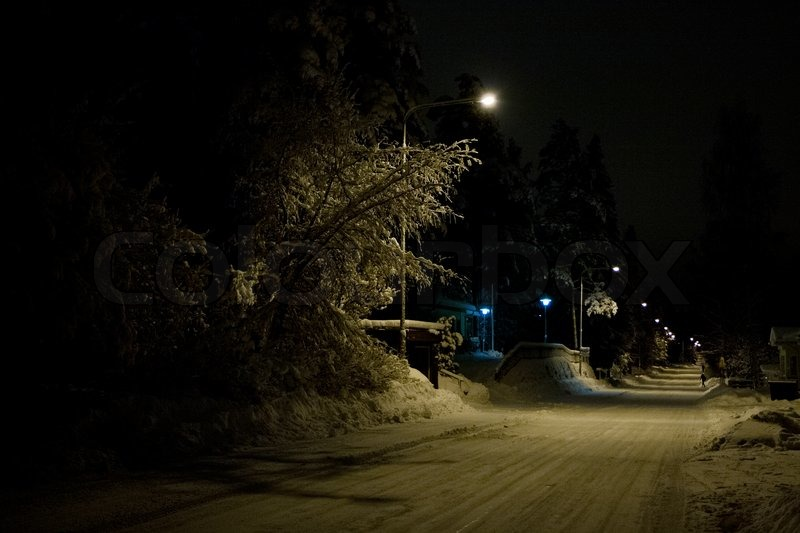 Empty Snowy And Dark Street Early In The Morning Stock