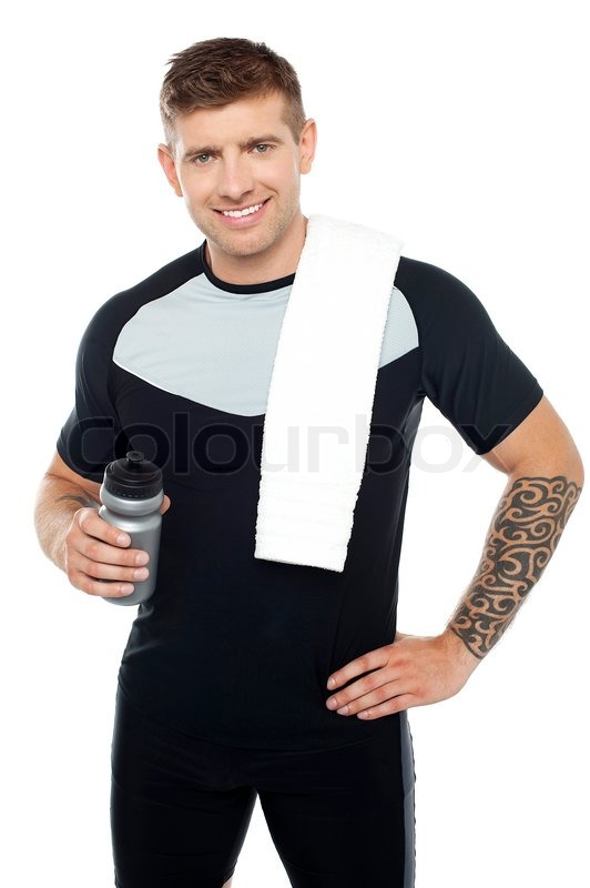 Energetic fit man holding water bottle | Stock Photo | Colourbox
