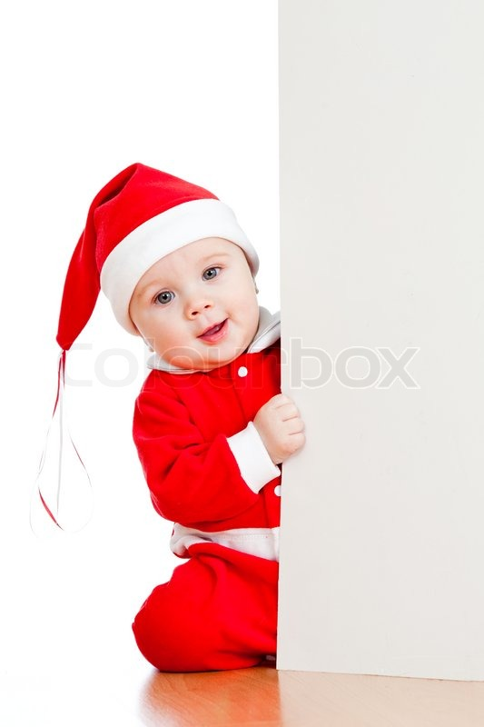 small santa claus child looking from behind the placard stock photo colourbox - Small Kids Images