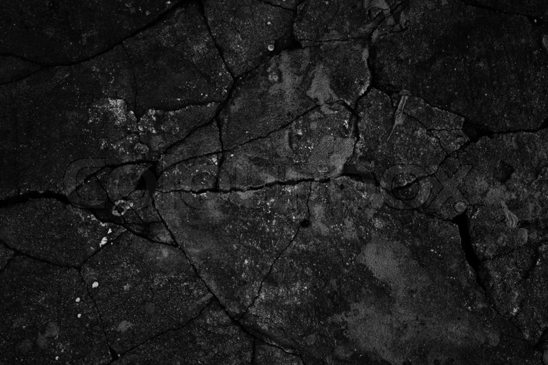 Stock image of 'Black cracked concrete texture closeup background'