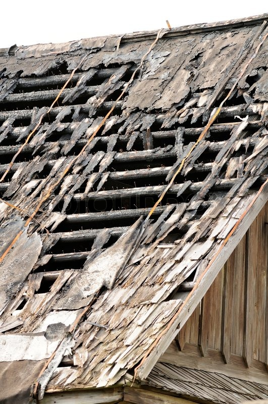 Broken Roof Of Old Abandoned Wooden House Stock Photo