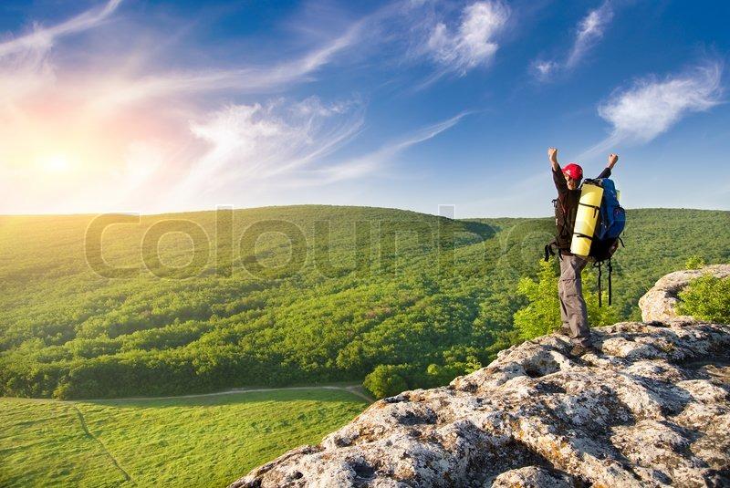 Man on top of mountain, stock photo