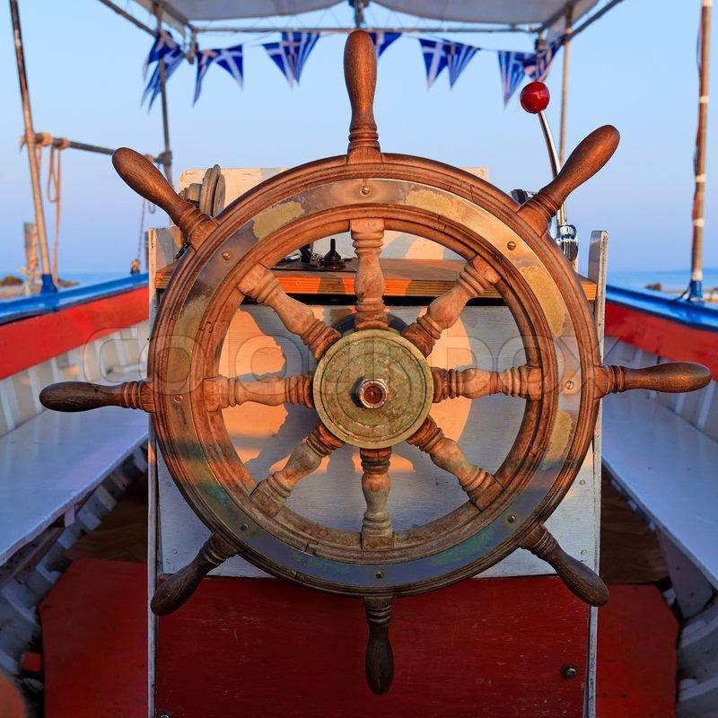 Steering boat wheel close-up | Stock Photo | Colourbox