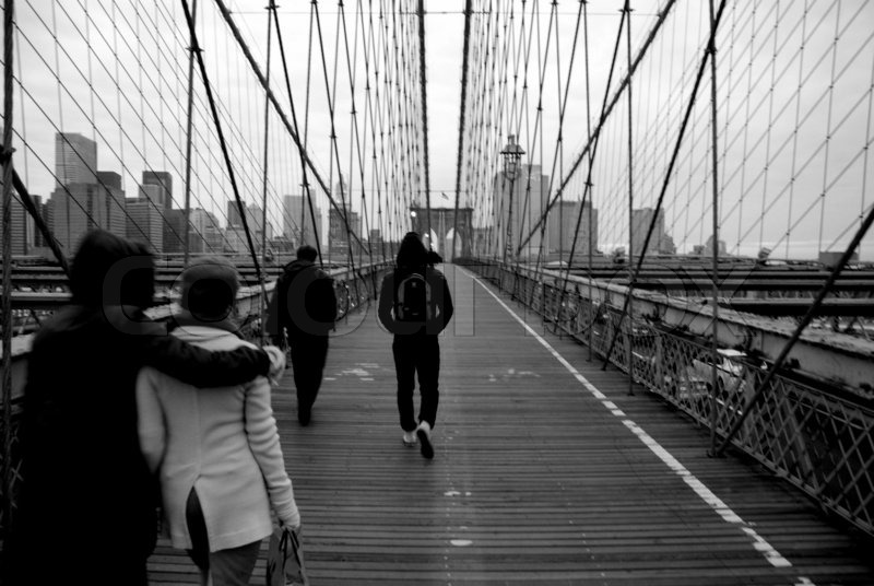 People Walking Over Brooklyn Bridge New York