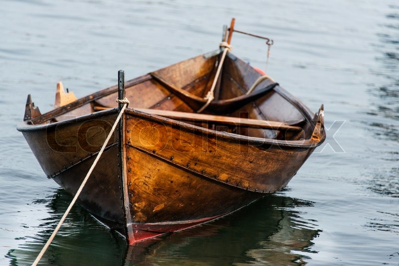 Wooden boat on water | Stock Photo | Colourbox