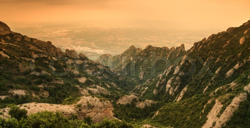 Stock image of 'Landscape with mountain Montserrat in Spain during a cloudy summer day'