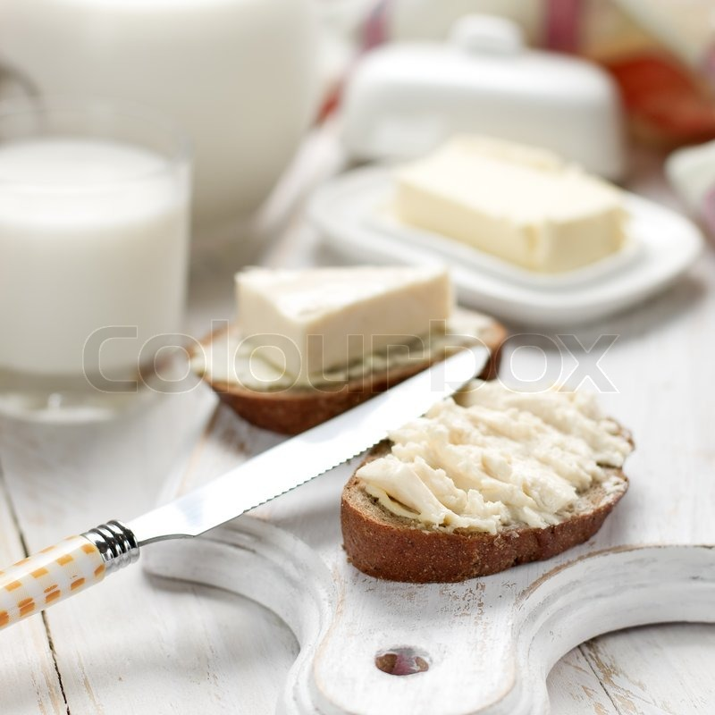 Slice of bread with cream cheese for breakfast | Stock ...