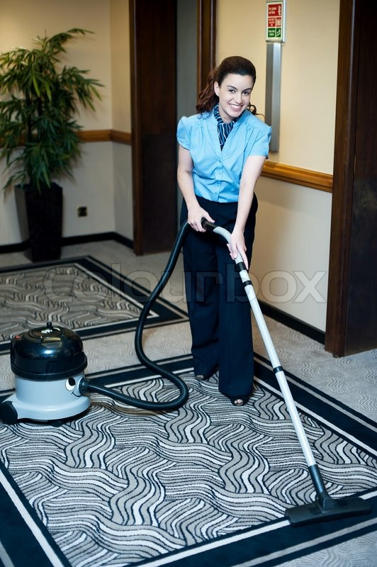 Staff Cleaning Carpet With A Vacuum Cleaner Stock Photo