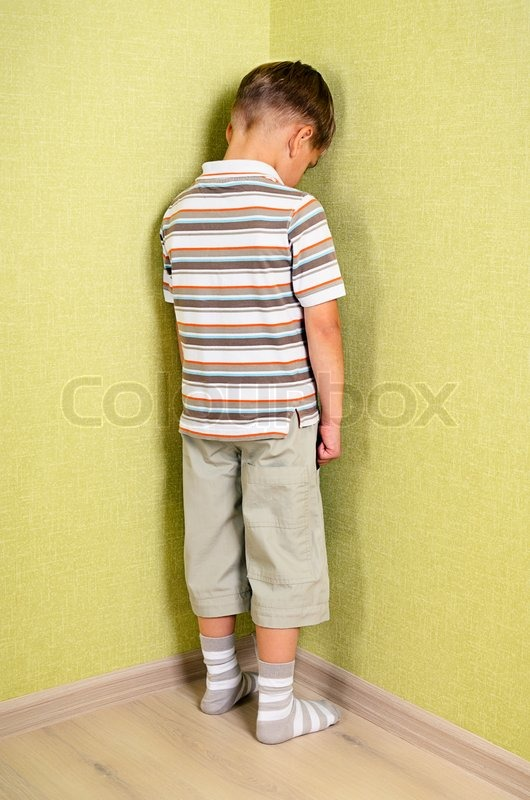 Standing In The Corner : Little child boy wall corner punishment standing stock