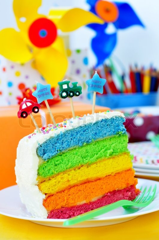 Slice Of A Birthday Rainbow Cake For Kids Party Stock Photo