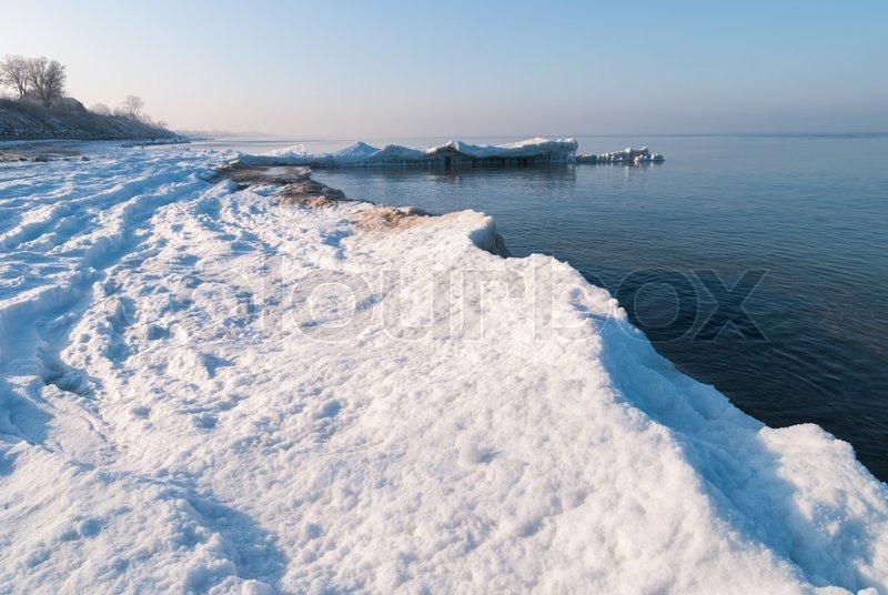 Ice-covered beach Baltic sea, stock photo