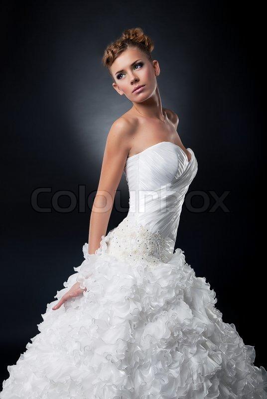 Beautiful young bride in bridal dress posing in studio | Stock Photo ...