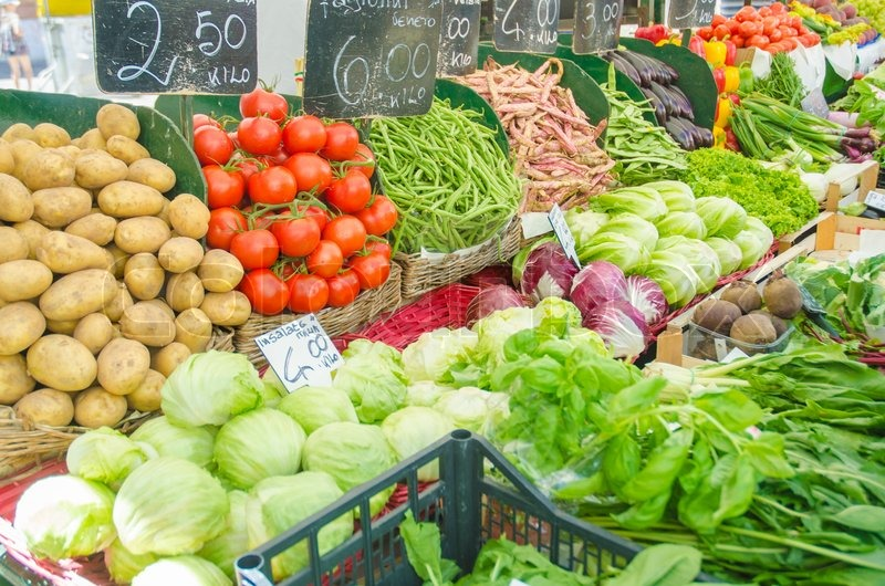 Stock image of 'Fruits and vegetables at the market stall'