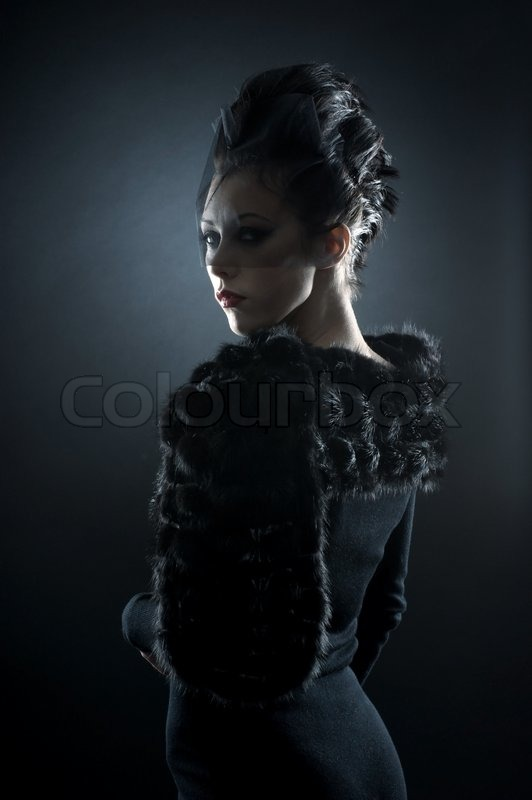 Portrait Of Female Vampire Over Dark Background Stock