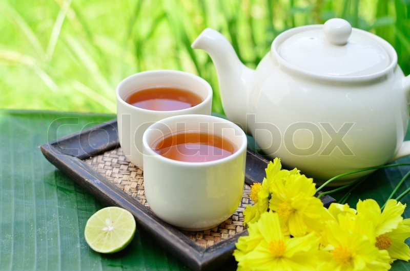Chinese tea in the morning whit yellow flower and green background chinese tea in the morning whit yellow flower and green background stock photo colourbox mightylinksfo