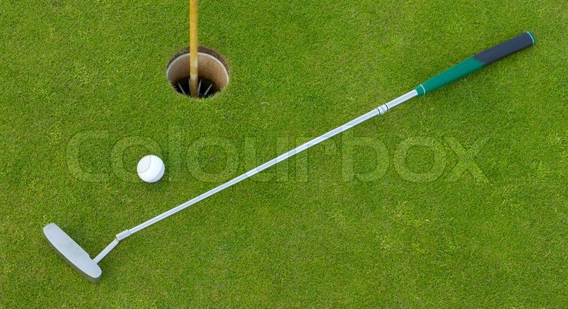 Golf hole with ball and putt, stock photo