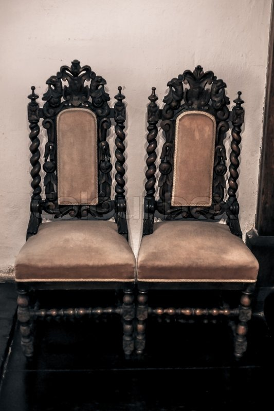 Antique gothic chairs up against the wall | Stock Photo ...