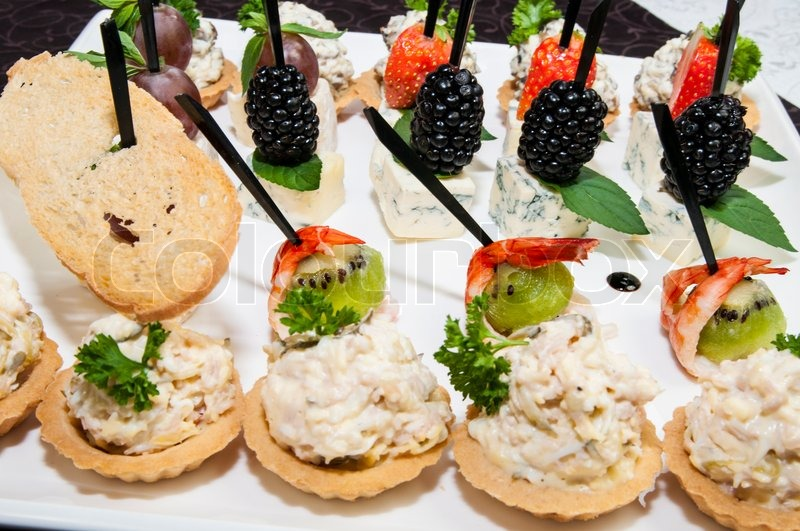 canape with cheese and berries on a plate in stock photo