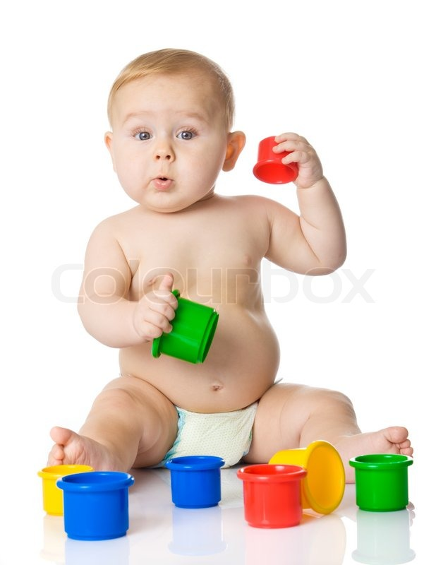 Baby playing with cup toys Isolated on white background ...