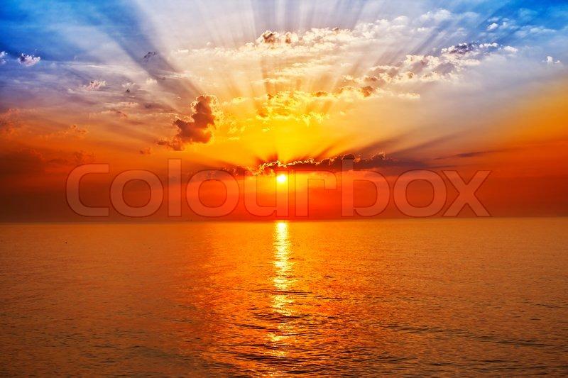 Sunrise in the sea, stock photo