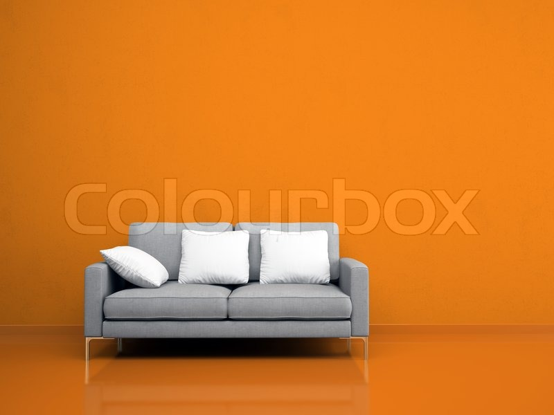 moderne grau sofa auf der orange wand stockfoto colourbox. Black Bedroom Furniture Sets. Home Design Ideas
