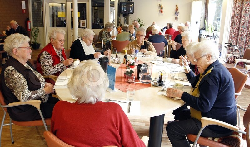 Old people having lunch in an elderly home | Stock Photo | Colourbox