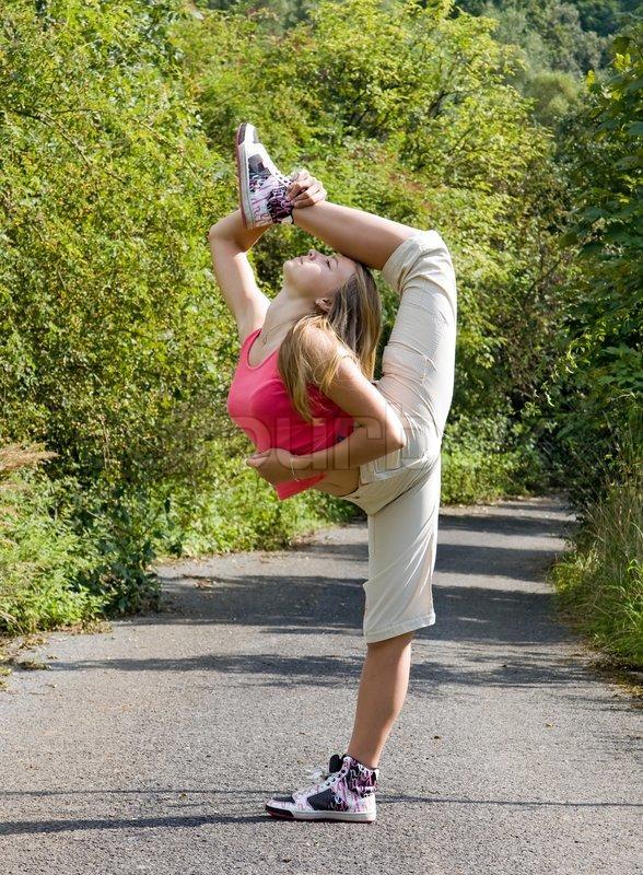 Beautiful girl standing on one leg, stock photo