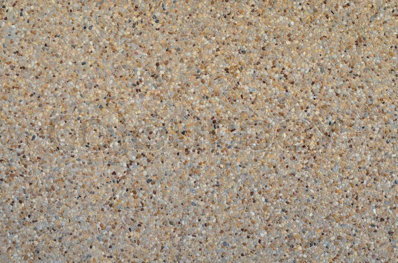 Brown Textured Concrete : Tiny gravel texture on brown concrete wall in sunny day