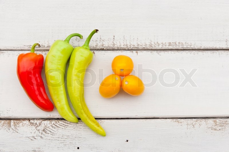Stock image of 'Colorful fruits and vegetables on white rustic wooden table'