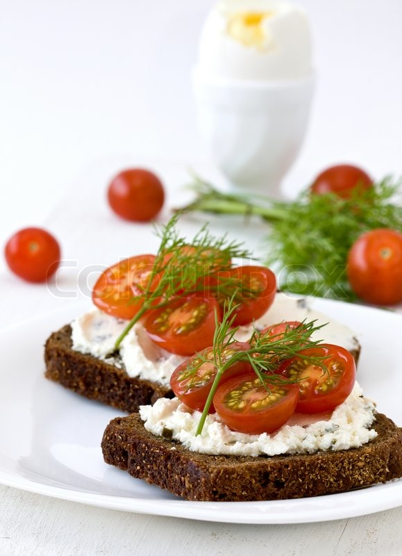 Breakfast sandwich of cottage cheese and red tomato, egg | Stock Photo ...